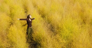 12883-girl-yellow-field-arms-raised-grass-wheat_1200w_tn